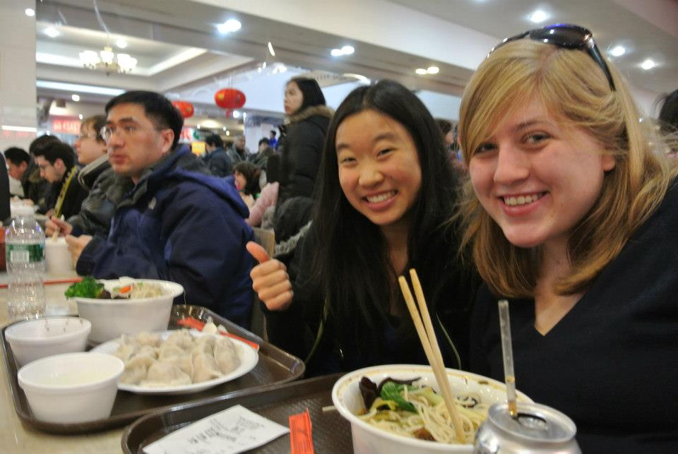 Meg and I eating our rice noodles after two hours of traveling!