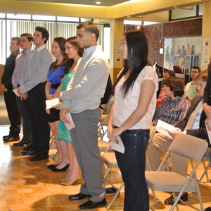 New members standing and taking their oaths of dedication to the society and responsibilities. (Picture taken by Stephanie Rollizo)