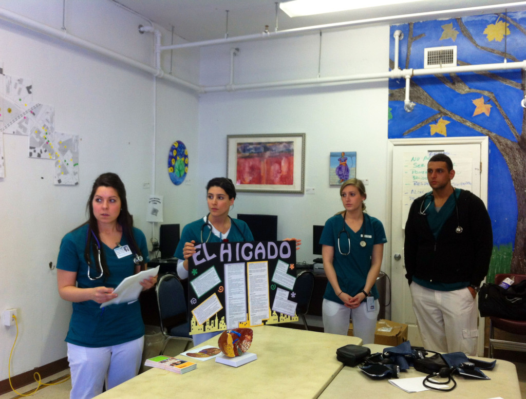 130320 Noelle DeNome, Stephanie Hopkins, Liz Harrington, Marcel Kaganovskaya teaching individuals at El Centro about caring for their liver and the functions of the liver