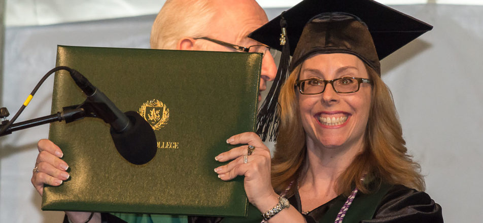 Melissa holding her diploma at commencement