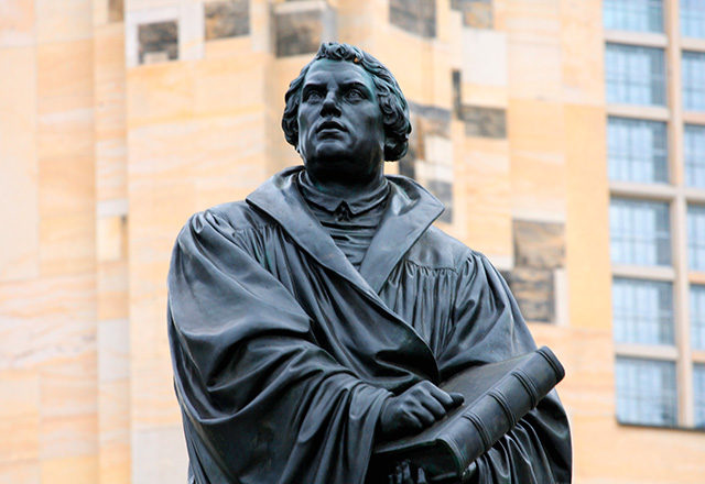 Statue of Luther holding a book.